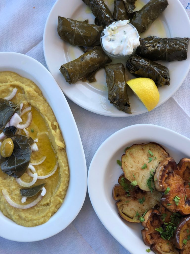 Dolma, Greek food, Greece food, Greek recipes, vegan Greek food, vegan Greek recipes, vegan tzatziki, vegan, vegetarian meals, vegetarian dishes, Dolmades, grape leaves, www.carlyknapp.com
